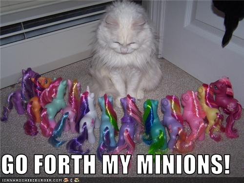 funny-pictures-cat-has-toy-pony-minions.